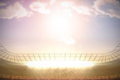 Large football stadium with spotlights under morning sky Royalty Free Stock Images