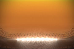 Large football stadium with spotlights under orange sky Royalty Free Stock Photos