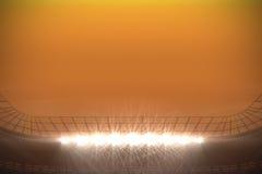 Large football stadium with spotlights under orange sky Royalty Free Stock Photos