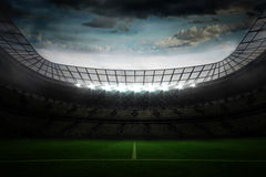 Large football stadium under blue sky Stock Photo