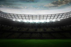 Large football stadium under blue sky Stock Photo