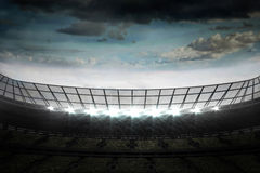 Large football stadium under cloudy sky Stock Images