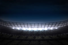 Large football stadium under night sky Stock Image