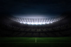 Large football stadium under night sky Stock Photography