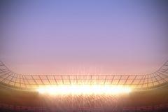 Large football stadium under purple sky Stock Photo