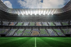 Large football stadium under spotlights Stock Images