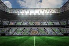Large football stadium under spotlights Stock Images