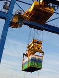 Large forklift stacking containers in port. Container transport vehicle closeup at harbor Stock Photo