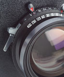 Large format camera lens in macro. Large format camera lens, macro shot of lens and shutter on lensboard Stock Photos