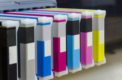 Large format ink jet printer toner casetas. Cartridge with paper roll macro close up stock images