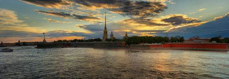Large-format panorama of the Peter and Paul fortress in St. Pete. Large-format panorama of the Peter and Paul fortress and the Cathedral at sunset in St stock photo