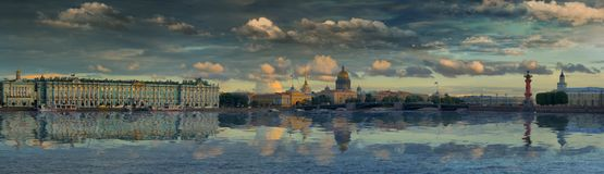 Large-format panorama of St. Petersburg and the Neva river against the picturesque sky. Large-format panorama of the Palace bridge, the Hermitage, St. Isaac`s stock image