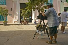 Large format photographer taking pictures in the historic areas of Old Havana, Cuba Stock Photography