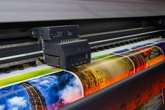 Large format printing machine in operation. Industry stock photos