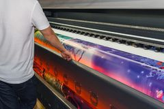 Large-format printing machine in the printing house. Industry royalty free stock images