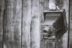 Large format retro camera, 5x7 inches. Photographer holds old studio camera. Monochrome effect, copy space. Concept - photography royalty free stock photos