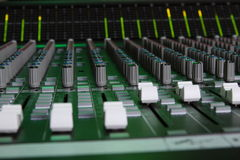 Large Format Sound Console Faders. 40ch Large format sound console faders with green light Stock Images