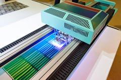 Large format UV coating printer. In work Stock Image