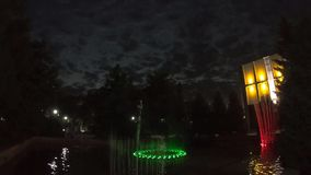 Large fountain in Almaty city at night stock video
