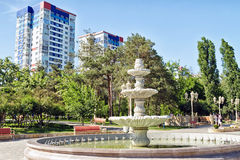 Large fountain in antique style mounted on  background high-ris Royalty Free Stock Photography