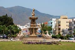 Large fountain with mermaids and seahorses, Estepona. Fountain at the junction of Avenida Juan Carlos I and the Avenida de Espana, Estepona, Malaga Province stock image