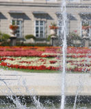 large fountain spraying water into the garden Stock Image