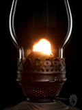 Shone oil lamp on the black. Stock Photo