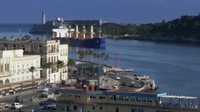 Large Freighter Cargo Ship Pulls into Havana Port Bay in Cuba. 8784 A large freighter cargo ship pulls into Havana Port Bay in Cuba stock video