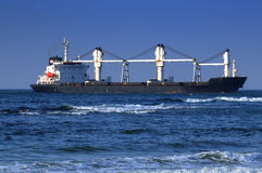 Large Freighter Crossing the Indian Ocean Off the Coast of Durban, South Africa Royalty Free Stock Image