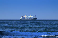 Large Freighter in the Distance Crossing the Indian Ocean, Off the Coast of Durban, South Africa Stock Images