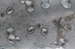 Large frozen water drops on glass close up. In winter Stock Photos