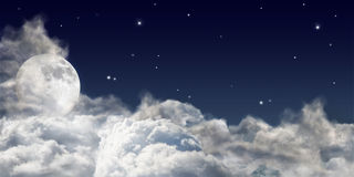 Large full moon above dark clouds. Dark sky with large clouds and full moon royalty free stock images