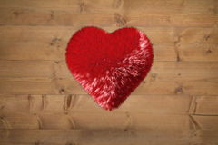 Large furry red heart. Red heart against bleached wooden planks background Stock Photos