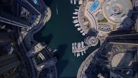 Large futuristic towers and modern skyscraper building in urban Dubai city panorama in stunning top aerial drone view. Stunning top 4k aerial drone view on huge stock video