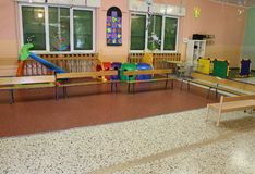 Game room in an asylum to educate small children with small benc. A large game room in an asylum to educate small children with small benches Royalty Free Stock Photo