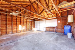 Large garage with concrete floor. stock photo