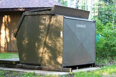 A large garbage bin at a campground.  Royalty Free Stock Photo