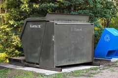 A large garbage bin at a campground.  Stock Photo