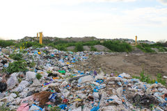 Large garbage dump outside of city Stock Image