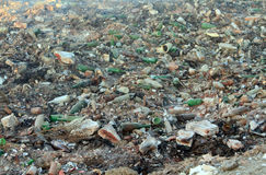 Large garbage dump waste with broken bottles Royalty Free Stock Photo