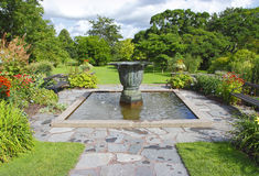 Large garden with fountain. Large well stocked garden with water fountain found in the botanical gardens of Gothenburg, Sweden Stock Photo