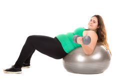 Large girl with exercise ball Stock Photos
