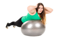 Large girl with exercise ball Royalty Free Stock Image