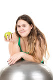 Large girl with exercise ball Stock Image