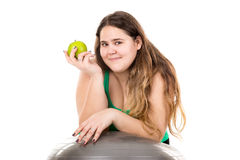 Large girl with exercise ball Stock Photography