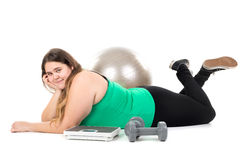 Large girl with exercise ball Stock Images