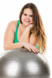 Large girl with exercise ball Royalty Free Stock Photography