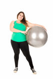 Large girl with exercise ball Royalty Free Stock Images