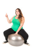 Large girl with exercise ball Royalty Free Stock Photos