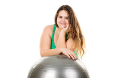 Large girl with exercise ball Royalty Free Stock Photo